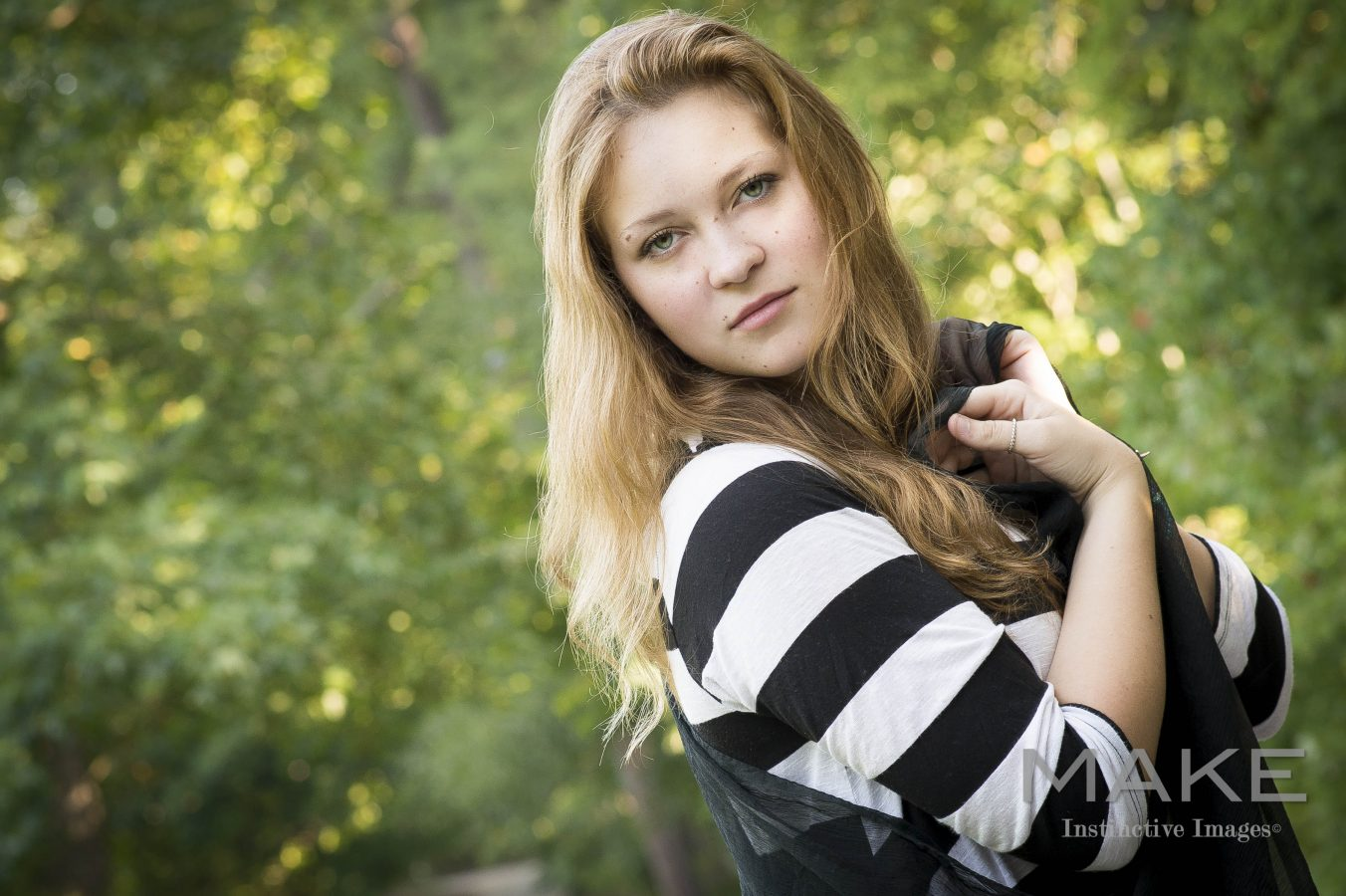 Young-Woman-holding-scarf-modern-senior-portrait-Roswell-Georgia