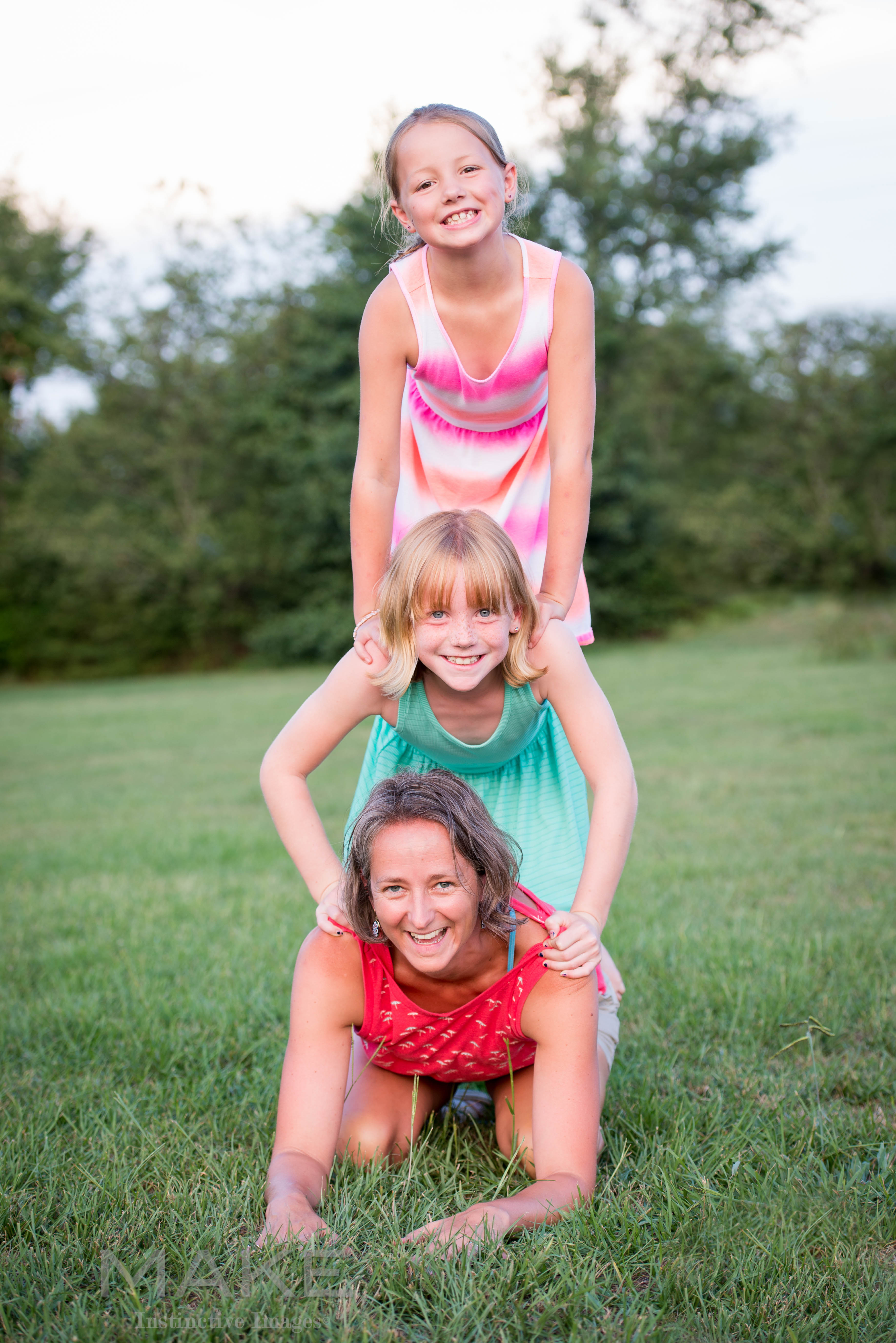 Mother-with-two-daughters-in-a-playful-candid-family-photo