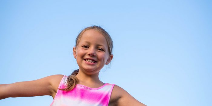 Young-Girl-Smiles-Big-in-a-candid-portrait