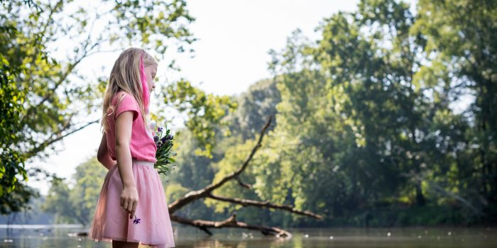 Candid-Portrait-Photography-Roswell-Young-Girl-with-Flower-in-chattahoochee-River